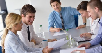 Group of happy young business people in a meeting at office_0